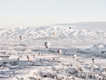 Hot Air Balloons over Winter Landscape