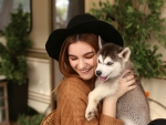 Cowgirl and her Siberian Husky Puppy