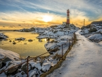 Lighthouse in the Snow at Sunset
