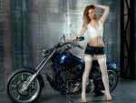 Model Posing with a Harley Davidson Motorcycle