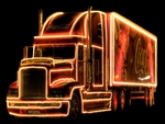 lighted coke truck in the dark