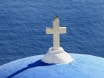 Cross with Bird in Santorini, Greece