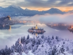 Beautiful Snowy Lake Bled at Sunrise