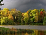 Looming Dark Clouds over Autumn Lake