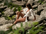 Brunette Sitting on a Rock