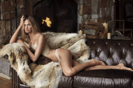 Elsa Hosk Ash Blonde on Leather Couch - ash blonde, fire and fire wood, stone  wall, brown leather couch, two piece lingerie, animal fur, candles