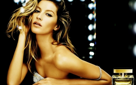 Gisele Bundchen modelling perfume - make up lighting, strapless, dark blonde, perfume bottle, silver dress, arm bracelet