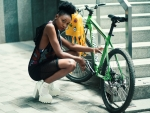 Girl & a green bicycle