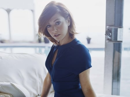 Alyson Hannigan - blue dress, red hair, pretty eyes, sliding glass doors, white pillows, bed