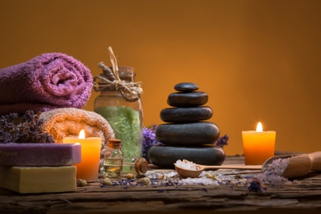 Spa background - table, stones, towel, candles