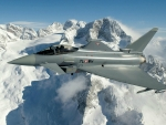 Fighter Jet over the Mountains