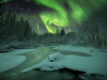 Northern Lights over Snowy Winter River