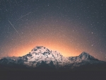 Mountains against starry sky