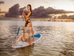 Stacy Cruz & Emily Willis on a Paddle Board