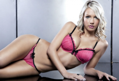 Laura Moro - laying o left side, platinum blonde, ring, pink lingerie, earrings