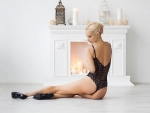 Sexy Woman by the Fireplace