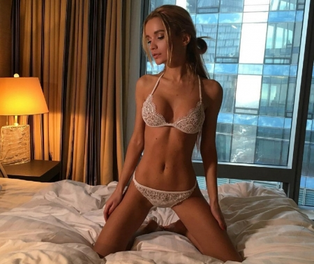 Ekaterina Zueva as a brunette - posing on bed, pony tail, brunette, large window, curtains, white lace bikini lingerie, side lamp