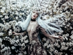 Ethereal Woman In Flowers Field