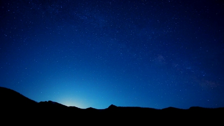Starry night sky over some mountains - Sky & Nature Background