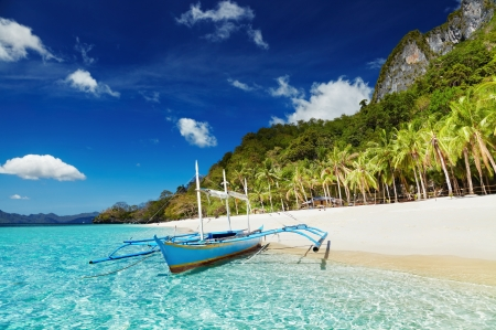 Beautiful island in Philippines - exotic, ocean, beautiful, sky, palms, sea, beach, boat, paradise, Phillippines, summer, island, tropics, blue