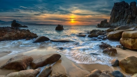 Sunset on the pebble beach - sea, beach, stones, sand, water, sunrise, pink, white, blue, rocks, sun, yellow, sunset, nice, amazing, horizon, foam, ocean, colors, waves, sky, cool, awesome