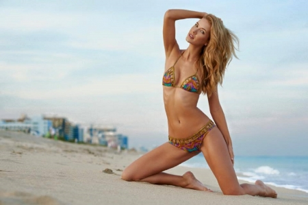 Olivia Jordan.........Photo credit Joey Wright - blonde, waves, sandy beach, bikini, buildings