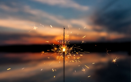 Sparkly Fire - pretty, orange, burning, sparks, yellow, fun, sunset, silhouette, clouds, 2560x1600, fire, water, mobile, hot, sparkler, blue