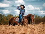 Cowgirl in a Field of Wheat