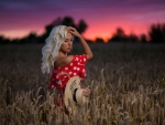 Cowgirl Margo in a Field of Wheat at Sunset