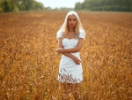 Pretty Woman in a Field of Wheat