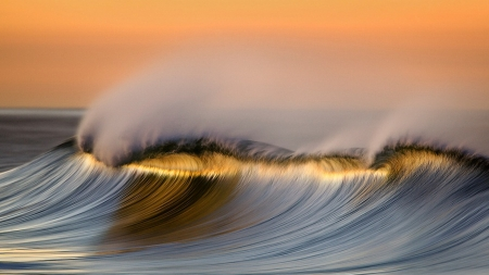 Sunset on the waves - sun, glow, gray, orange, beautiful, sunset, sea, wave, beach, photography, gold, nice, splendor, evening, blue, photo, amazing, ocean, colors, sky, water, cool, salmon, summer, awesome, day, sunshine, spray, pastel, nature, white, reflections