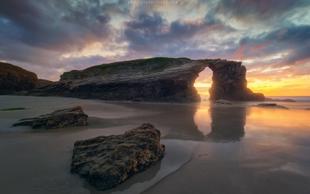 Rock on Beach in Spain - beach, arch, rock, sunset, Spain, clouds, sea