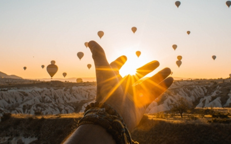 Touch the Sun - mountains, touch, snow, hand, sunrise, hot air balloons, sky
