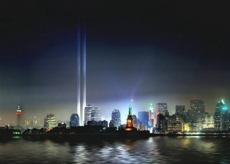 WE MUST NEVER FORGET - search lights, night time, double beams, statue of Liberty, NY city lights