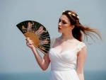 Lady With Hand Fan