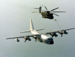 A USMC C-130 refuels a CH-53 Helicopter