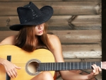 Cowgirl Playing the Guitar