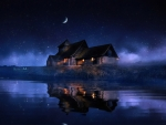 A house on the river bank on a moonlit starry night