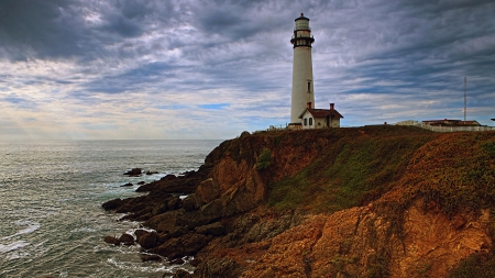 Lighthouse on the Shore - shore, nature, lighthouse, rocks, cliff, coast