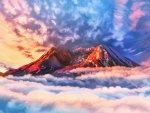 Mountain Peaks Above The Clouds