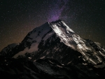 Luming mountain backdropped by a purple night sky filled with stars