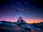 Snowy mountain backdropped by a beautiful star-filled sky