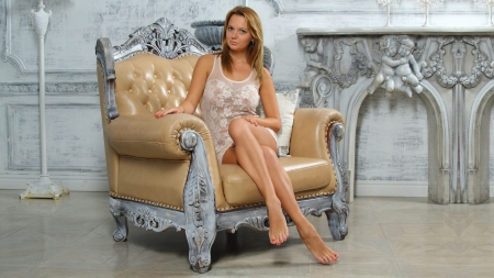 Beautiful woman on the armchair