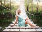 Girl on the wooden bridge