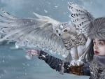 Girl and snowy owl