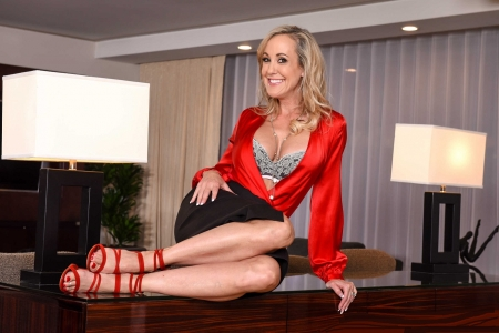 Tracey Lynn Livermore - sexy look, posing on office desk, side lamps, recessed lighting, gray vertical blinds, red blouse, blonde, black skirt, rings, red strapped sandals, long necklace