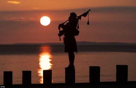 VE DAY: VICTORY IN EUROPE DAY MAY 8-10 - BAGPIPES, LONE SCOTSMAN, SUNSET SCENE, WATER