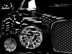 Headlamps of black Bentley