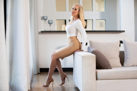 Tracey Lynn Livermore - sheers, sofa arm, window, leaning, necklace, blonde, tiled counter, camel dress with white top