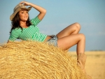 Cowgirl on a Hay Bale